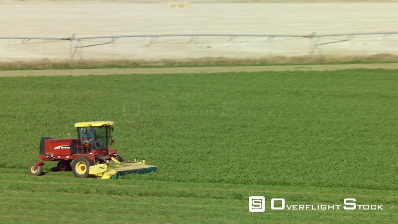 A New Holland HW345 cuts alfalfa in the Madison valley in southwestern Montana