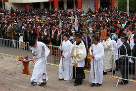 Assistants arriving with bible, lamps, crucifix and incense burner at start of central mass, Virgen de la Candelaria festival, Puno, Peru