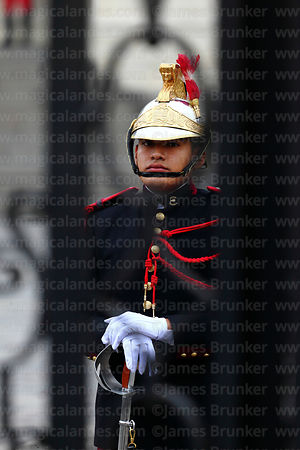 Portrait of ceremonial guard seen through railings in front of government palace, Plaza de Armas, Lima, Peru