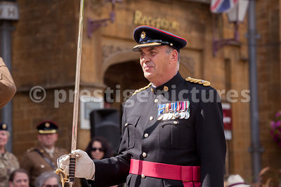 The Squadron Sgt Maj salutes and hands the parade over to his OC, maj Jeremy Burnan RLC