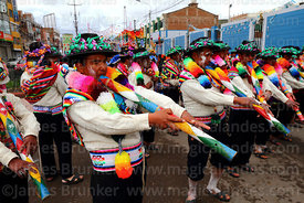 Musicians from Lampa village playing large quena flutes, Virgen de la Candelaria festival, Puno, Peru