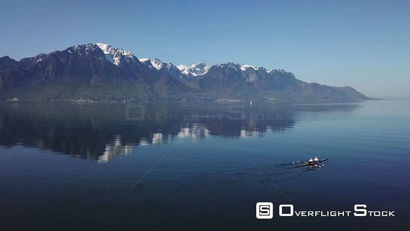 Aerial view of rowers on Geneva lake by Montreux Riviera in the morning, filmed by drone, Montreux, Swiss