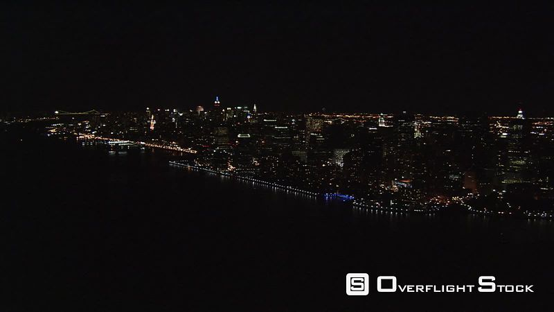 Night flight approaching lower Manhattan from Hudson River.