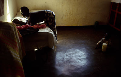 Burundi - Ruyigi - An orphan girl cares for  two others, both with HIV