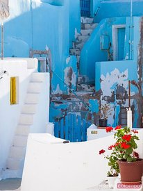 Glimpse of typical white houses in Oia Santorini Greece
