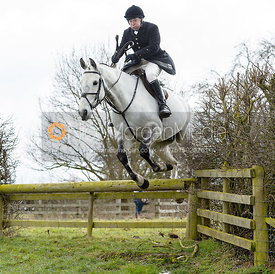 Richard Hunnisett jumping a hunt jump - The Cottesmore Hunt at Grange Farm
