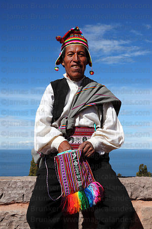 Men chewing coca leaves (kept in a woven bag called a ch'uspa), Taquile Island , Peru