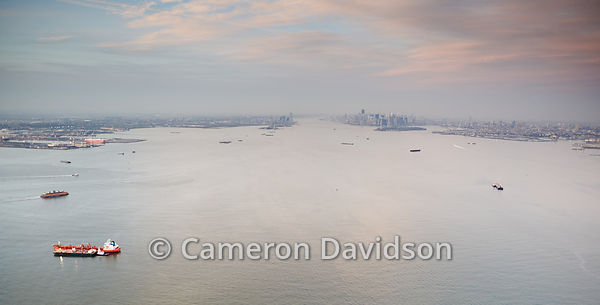 Aerial of New York Harbor in the early evening.