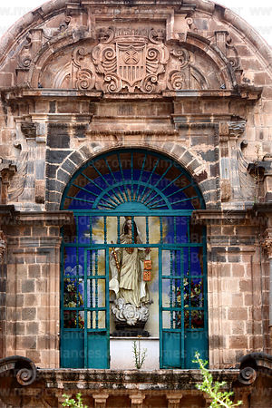 Statue of Virgen de La Merced above main entrance of  La Merced church, Cusco, Peru