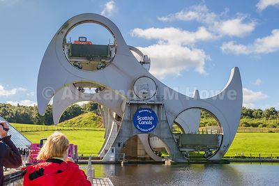 The Falkirk Wheel rotating with a pleasure boat on board