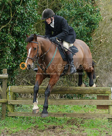 Charlie Smith jumping a hunt jump near Knossington Spinney