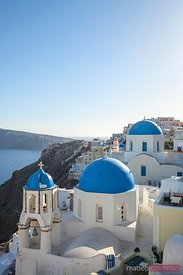 Blue domed churches and mediterranean sea, Santorini, Greece