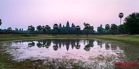 Angkor Wat temples at sunrise reflected into water, Cambodia