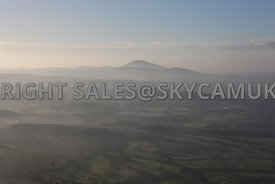 The Wrekin aerial photograph of the cone of the extinct volcano rising above the landscape on a misty winter's day