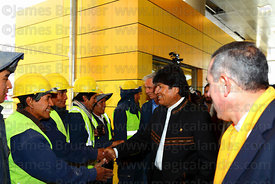 Bolivian president Evo Morales (centre) greets Mi Teleferico company workers as he arrives for the opening ceremony of the Yellow Line cable car, La Paz, Bolivia