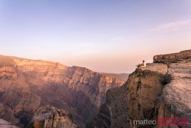 Oman, Jebel Shams. The Grand canyon with tourist on the edge