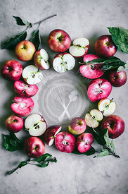 Pink and white apple flatlay with leaves