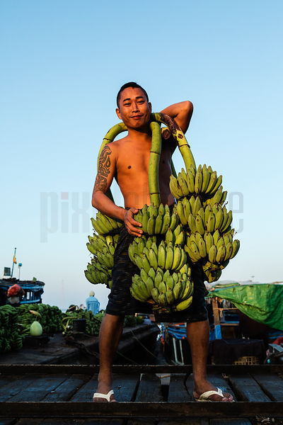 Wharfside Worker Carrying Bananas