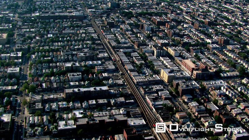 Flight over Brooklyn, with railway cutting in center frame.