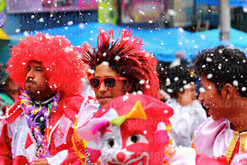 Revellers in fancy dress dancing during parades for the Entierro del Pepino, La Paz, Bolivia
