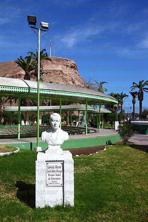 Statue of Chilean writer Gabriela Mistral, El Morro headland in background, Arica, Region XV, Chile