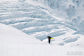 Snowboarder against glacier