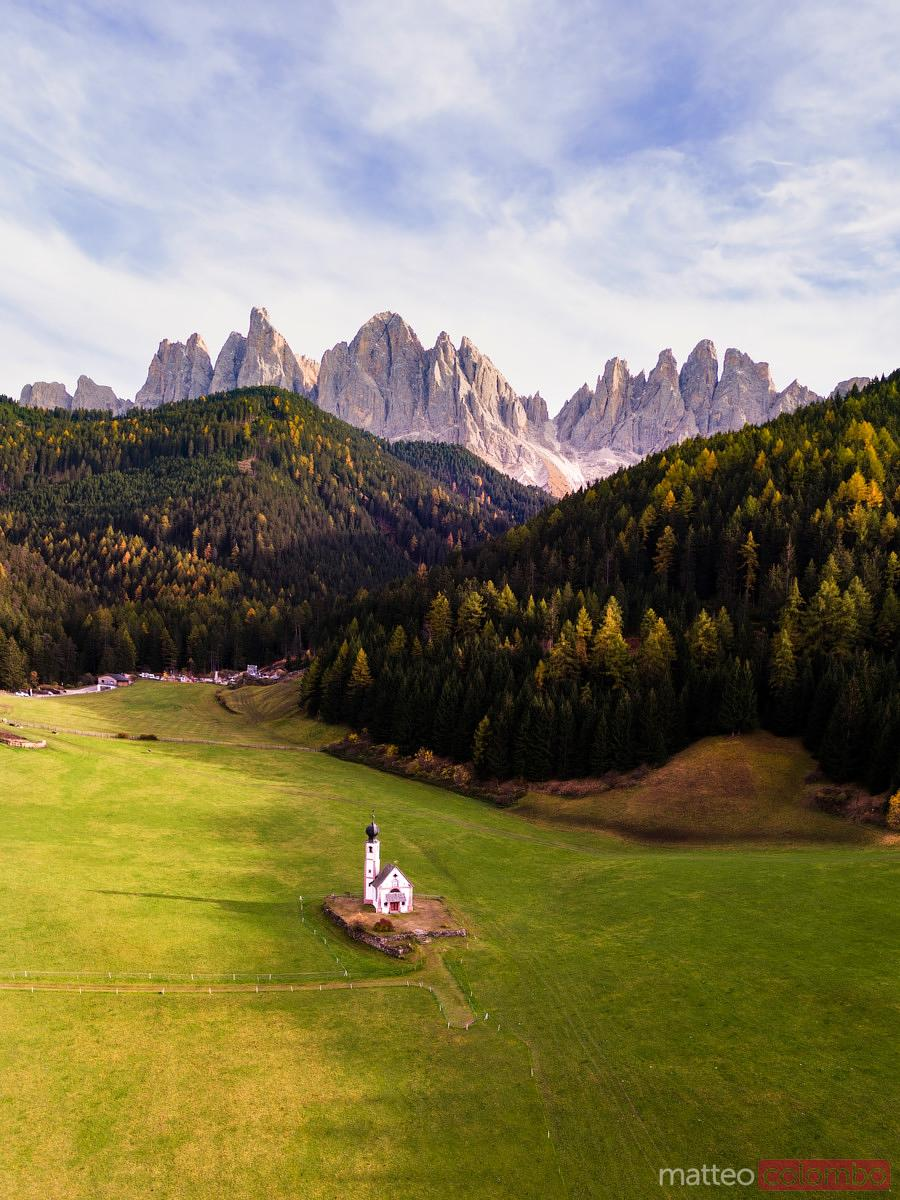 Aerial drone view of church, Funes, Dolomites, Italy