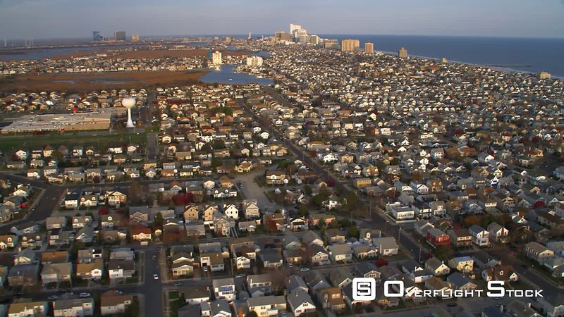 Aerial approach from Ventnor City north towards Ventnor city pier with Atlantic City, NJ in the distance.