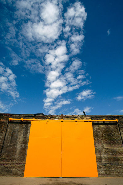 Industrial building with orange door