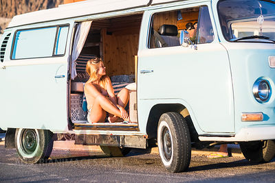 Spain, Tenerife, blonde woman sitting in an old van