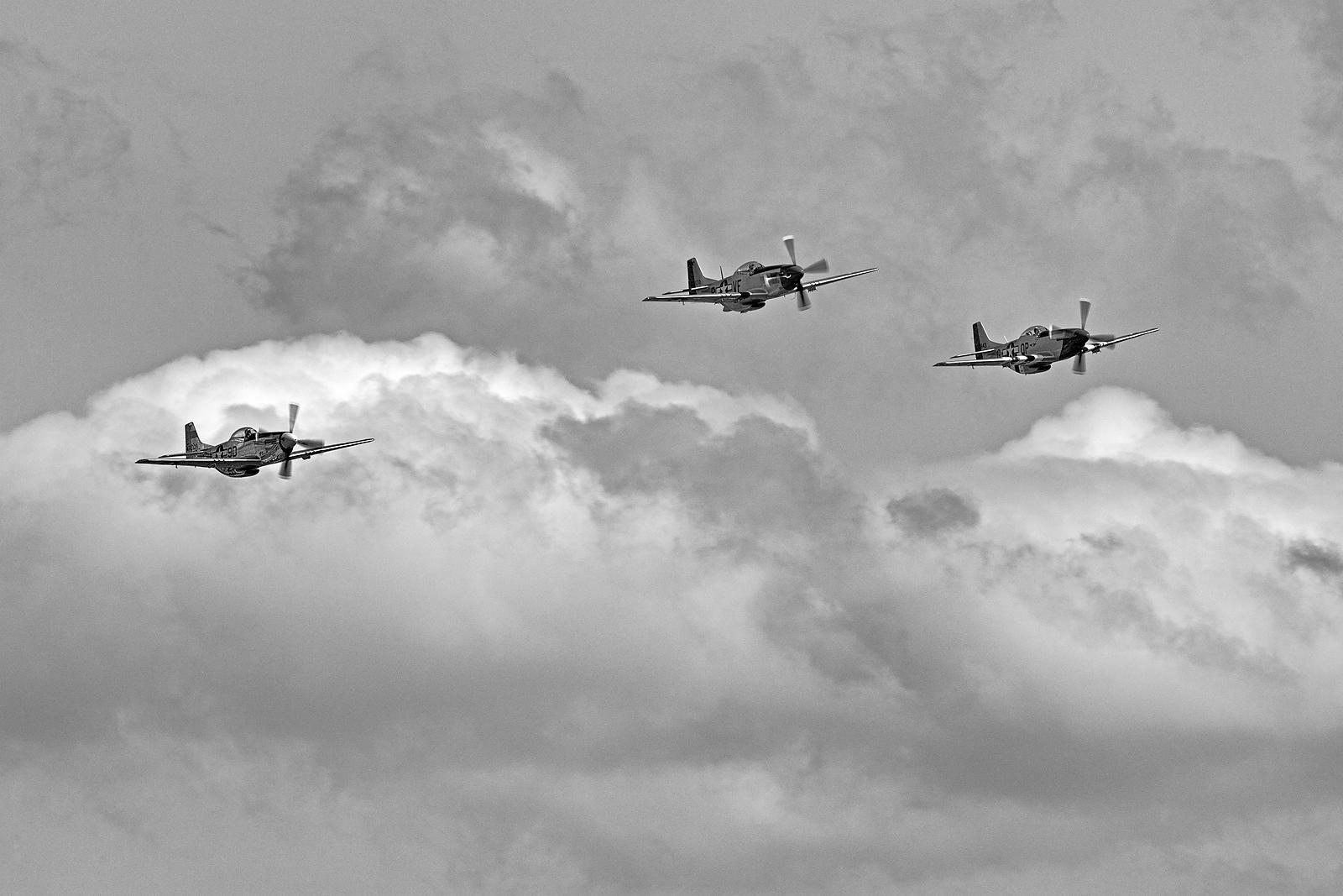 "P-51 Muatangs in ""Missing Man"" Formation"