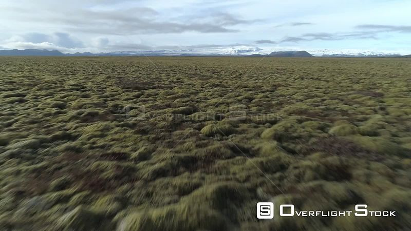 Over Endless Fields of Moss, Icelandic Tundra Under Glacier, Revealing Shot