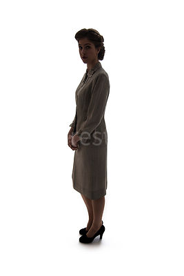 A silhouette of a 1940's / 1950's woman, standing in a suit – shot from eye-level.