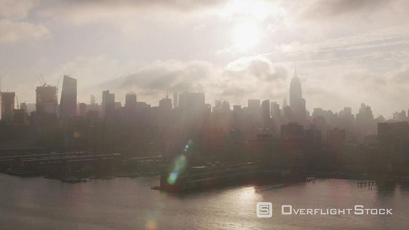 New York City Flying up Hudson River at sunrise with Manhattan buildings and piers.  Shot with Cineflex and RED EpicW Helium.