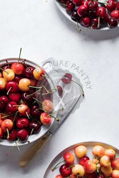 Fresh ripe cherries in a bowl