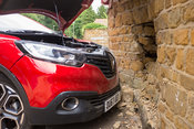 New car crashed into Stone house wall