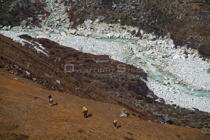 NEPAL Near Machermo -- Porters head out from Machermo in the Gokyo valley of the Khumbu (Everest region) of Nepal