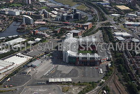 Manchester aerial photograph of Manchester United Stadium and John Gilbert Way looking towards Exchange Quay and Trafford road