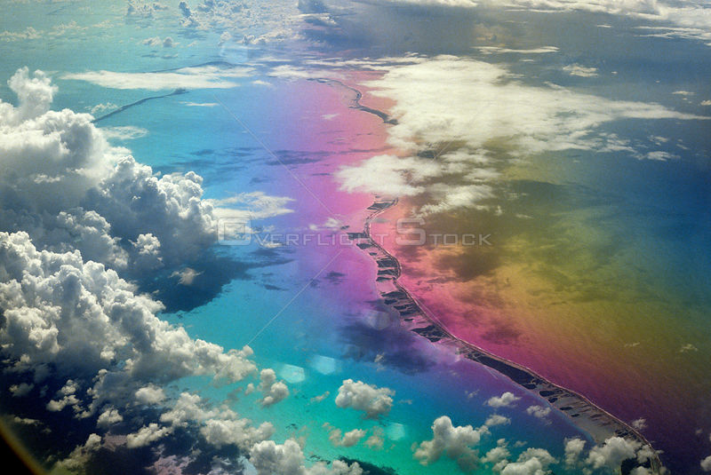 Aerial view of Rangiroa Atoll, the largest atoll of French Polynesia's Tuamotu archipelago, located in the central south Pacific Ocean. The strange colours are due to the sunlight on the aircraft window.