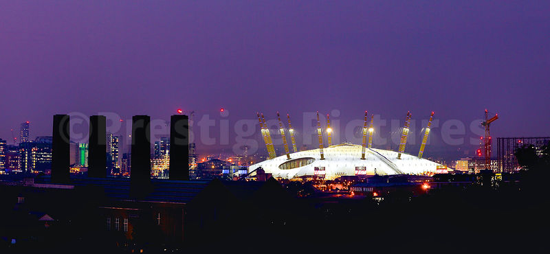 o2 Arena Lit up at Night with the Chimneys of Greenwich Power Station in the Foreground
