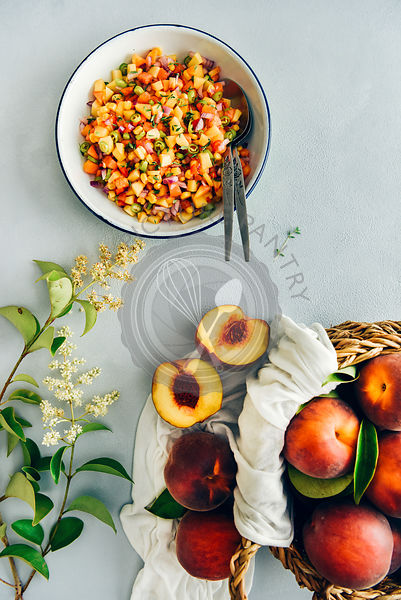 Peach salsa in a white bowl