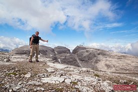 Hiker on the peak of a mountain Dolomites Italy