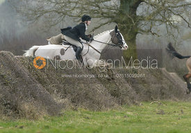 Jumping a hedge at Leicester Lane