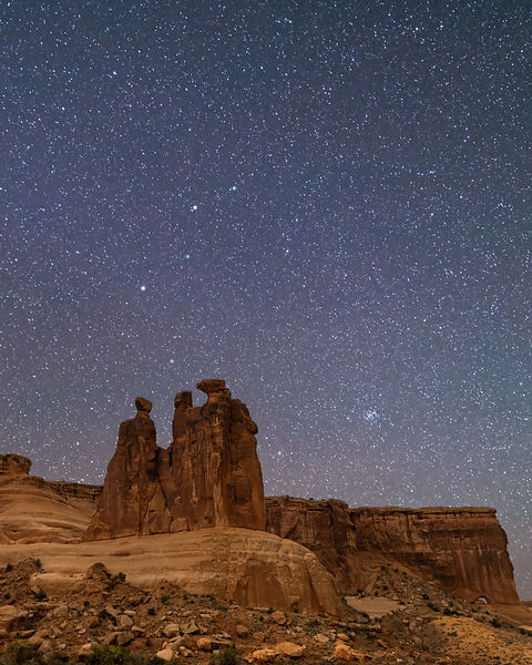 Cassiopeia Rising Over the Three Gossips