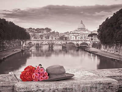 Bunch of roses and hat on bridge near Basilica di San Pietro in Vatican, Rome, Italy