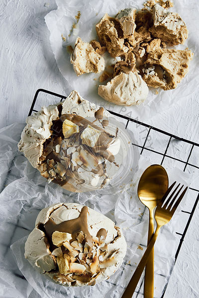 Toasted coconut and caramel meringues with dehydrated pineapple.