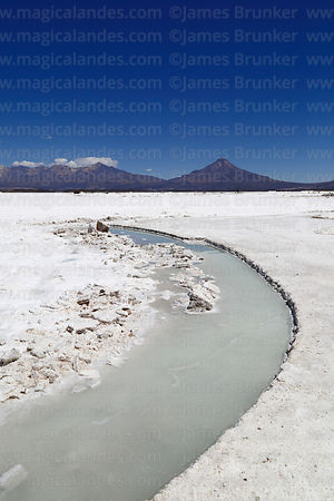 Channel formed by removing salt blocks, Tata Sabaya volcano (R) in background, Salar de Coipasa, Oruro Department, Bolivia