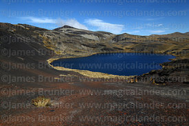View across barren hills and Laguna Patalarama, Cordillera Real, Bolivia