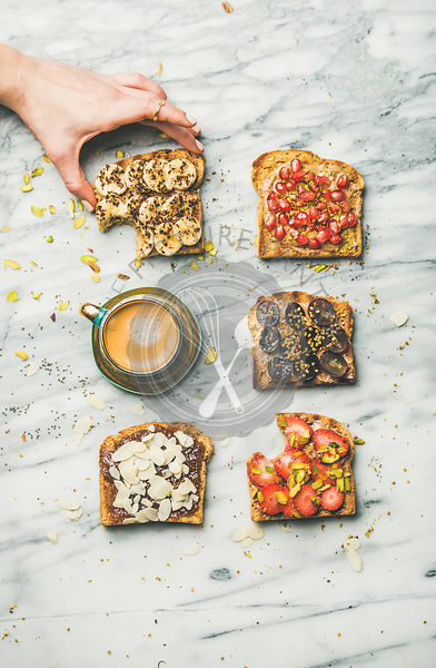 Healthy breakfast with wholegrain toasts , coffee over marble background