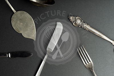 Vintage metallic cutlery and kitchen utensils